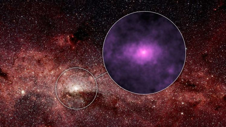 NASA's Nuclear Spectroscopic Telescope Array, or NuSTAR, has captured a new high-energy X-ray view (magenta) of the bustling center of our Milky Way galaxy. Image credit: NASA/JPL-Caltech