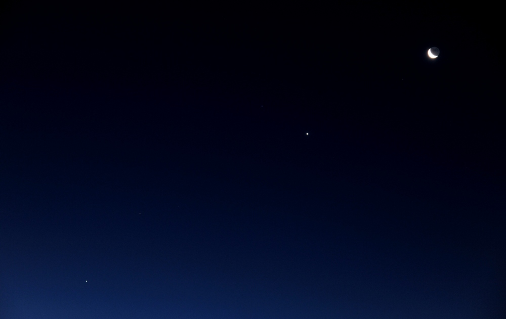 Objects on the morning sky. Early October 2015. Jupiter, Mars, Venus and the Moon - in a line from lower left to upper right.