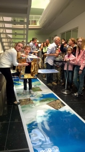 A young visitor at ESTEC Open Day event 2015 moves across the Earth like an European Sentinel satellite, attempting to make a laser link with a high-orbiting EDRS communication satellite.